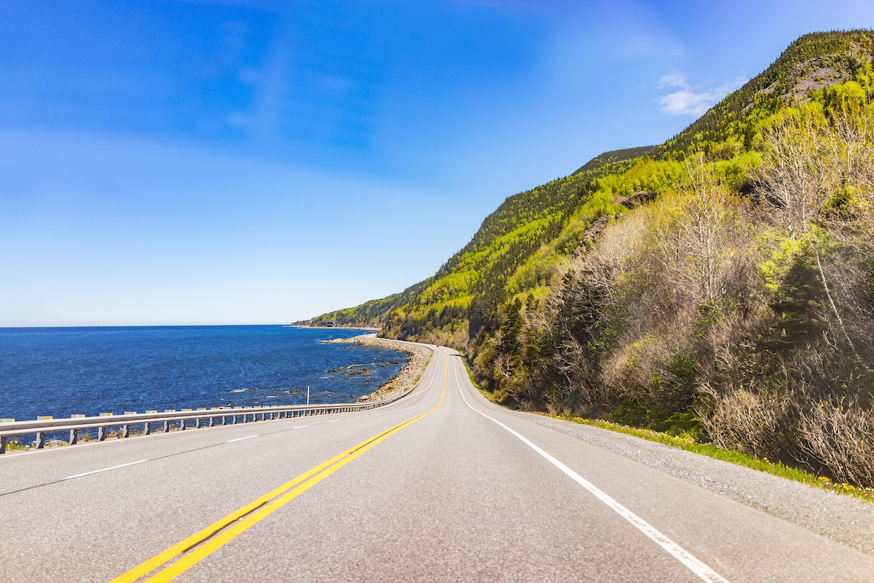 Coast of Gaspesie region of Quebec, Canada with road, cliffs and Saint Lawrence river ocean