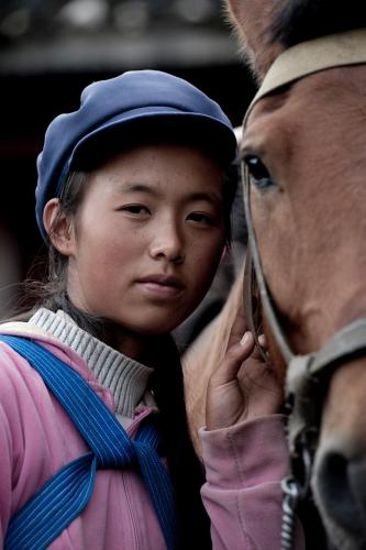 Day 6, in Yuhu (near Lijiang): a Naxi lady with her horse...